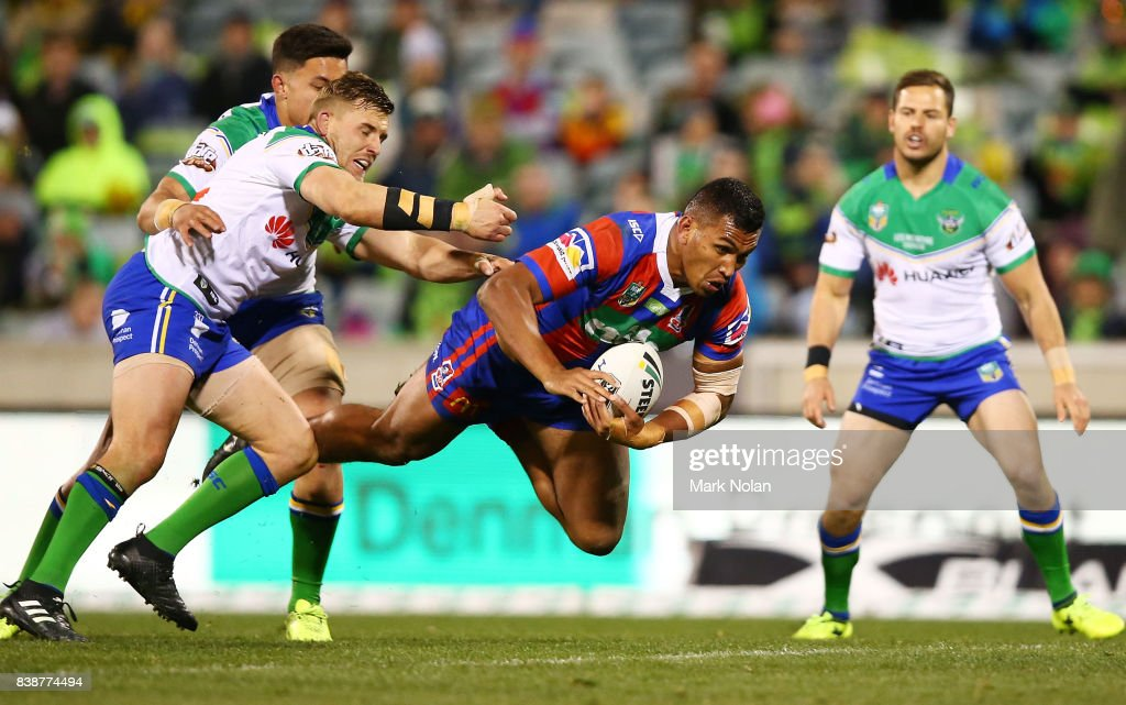 Jacob Saifiti of the Knights is tackled during the round 25 NRL match between the Canberra Raiders and the Newcastle Knights at GIO Stadium on August 25, 2017 in Canberra, Australia.