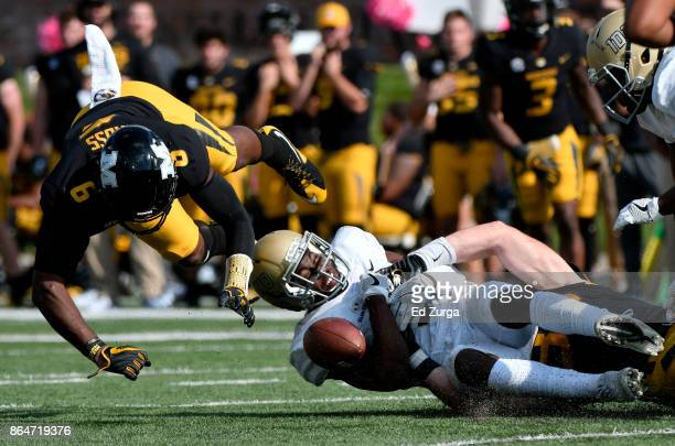 Jacob Sannon of the Idaho Vandals drops the ball for a incomplete pass as he is hit by Tavon Ross of the Missouri Tigers in the fourth quarter at...