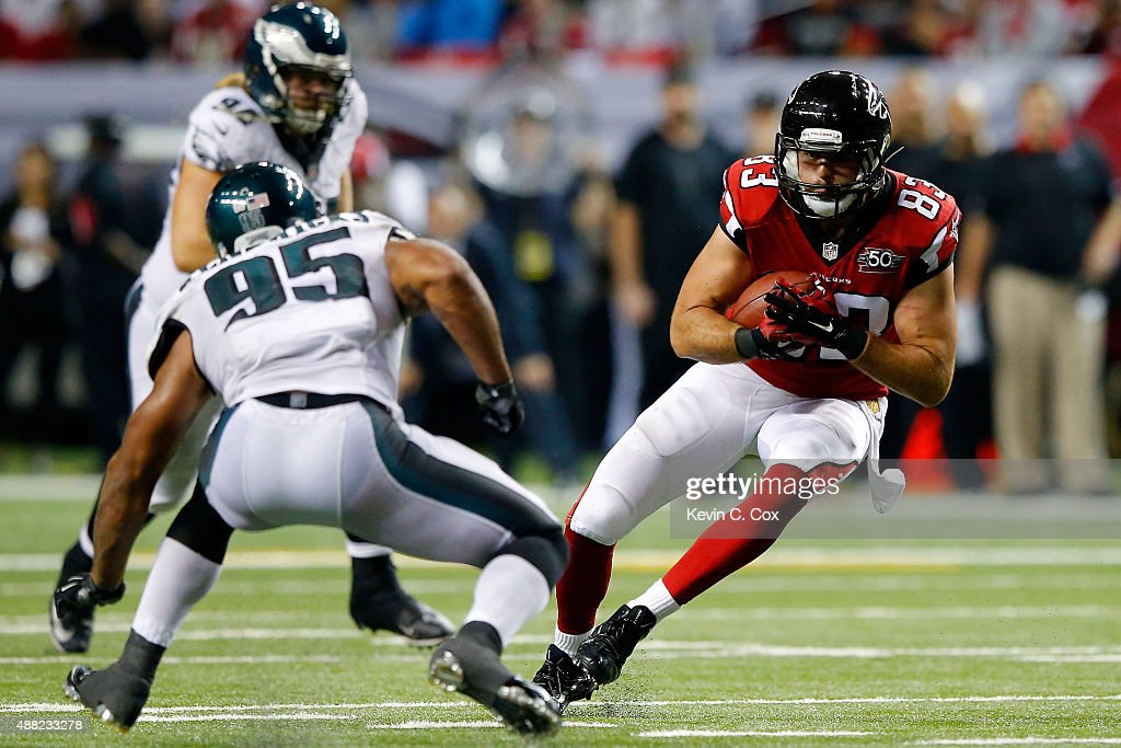 <a gi-track='captionPersonalityLinkClicked' href=/galleries/search?phrase=Jacob+Tamme&family=editorial&specificpeople=2128594 ng-click='$event.stopPropagation()'>Jacob Tamme</a> #83 of the Atlanta Falcons runs past <a gi-track='captionPersonalityLinkClicked' href=/galleries/search?phrase=Mychal+Kendricks&family=editorial&specificpeople=5543514 ng-click='$event.stopPropagation()'>Mychal Kendricks</a> #95 of the Philadelphia Eagles after a catch during the second half at the Georgia Dome on September 14, 2015 in Atlanta, Georgia.