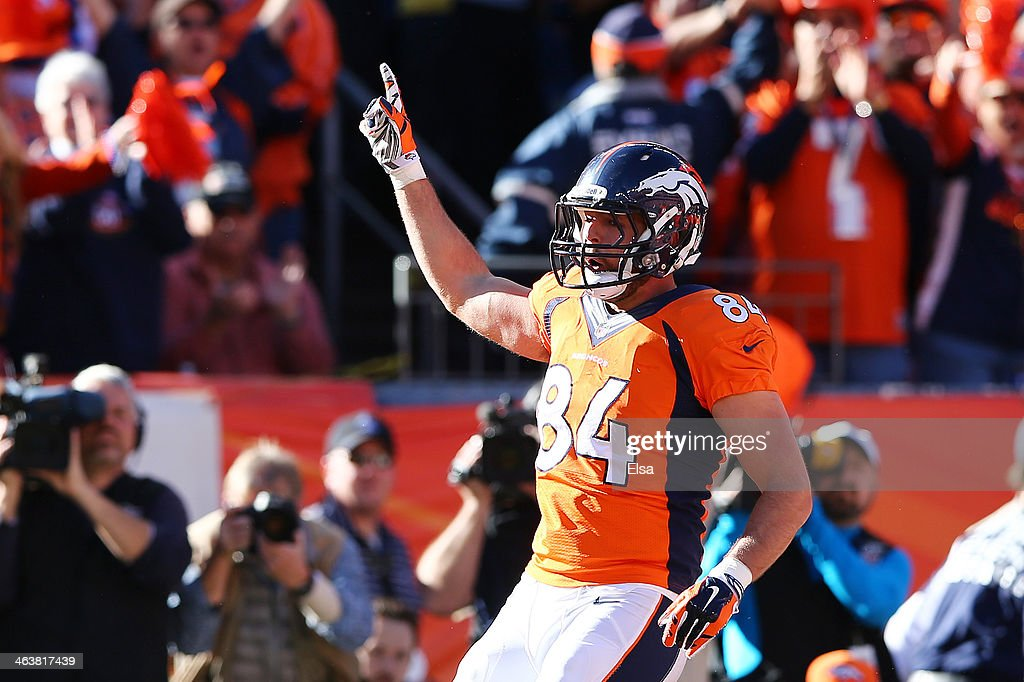 <a gi-track='captionPersonalityLinkClicked' href=/galleries/search?phrase=Jacob+Tamme&family=editorial&specificpeople=2128594 ng-click='$event.stopPropagation()'>Jacob Tamme</a> #84 of the Denver Broncos celebrates his second quarter touchdown against the New England Patriots during the AFC Championship game at Sports Authority Field at Mile High on January 19, 2014 in Denver, Colorado.