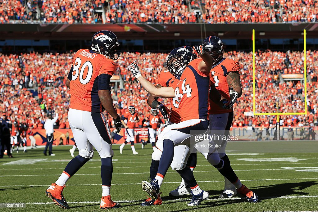 <a gi-track='captionPersonalityLinkClicked' href=/galleries/search?phrase=Jacob+Tamme&family=editorial&specificpeople=2128594 ng-click='$event.stopPropagation()'>Jacob Tamme</a> #84 of the Denver Broncos celebrates his second quarter touchdown with teammates during the AFC Championship game against the New England Patriots at Sports Authority Field at Mile High on January 19, 2014 in Denver, Colorado.