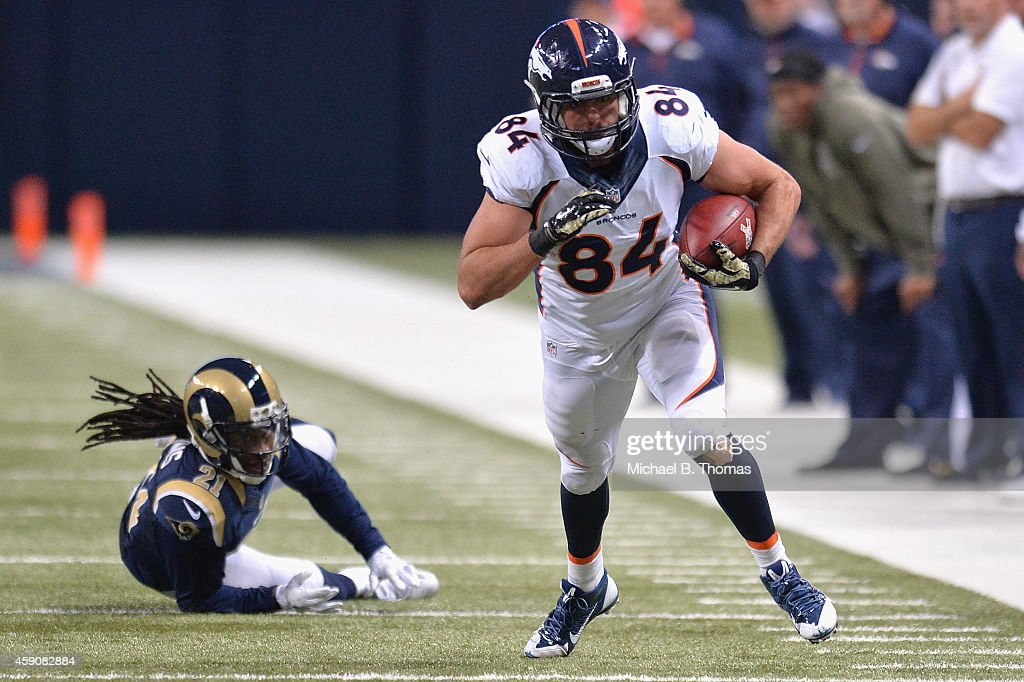 <a gi-track='captionPersonalityLinkClicked' href=/galleries/search?phrase=Jacob+Tamme&family=editorial&specificpeople=2128594 ng-click='$event.stopPropagation()'>Jacob Tamme</a> #84 of the Denver Broncos rushes after a catch against the St. Louis Rams at the Edward Jones Dome on November 16, 2014 in St. Louis, Missouri. The Rams defeated the Broncos 22-7.