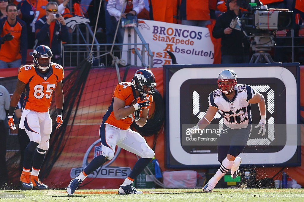 <a gi-track='captionPersonalityLinkClicked' href=/galleries/search?phrase=Jacob+Tamme&family=editorial&specificpeople=2128594 ng-click='$event.stopPropagation()'>Jacob Tamme</a> #84 of the Denver Broncos scores a second quarter touchdown against the New England Patriots during the AFC Championship game at Sports Authority Field at Mile High on January 19, 2014 in Denver, Colorado.