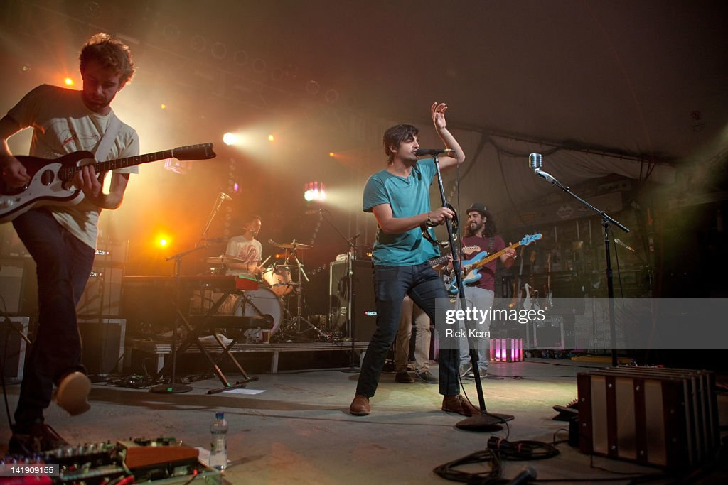 Jacob Tilley, François Comtois, Sameer Gadhia, and Payam Doostzadeh of Young the Giant perform at Stubb's Bar-B-Q on March 25, 2012 in Austin, Texas.