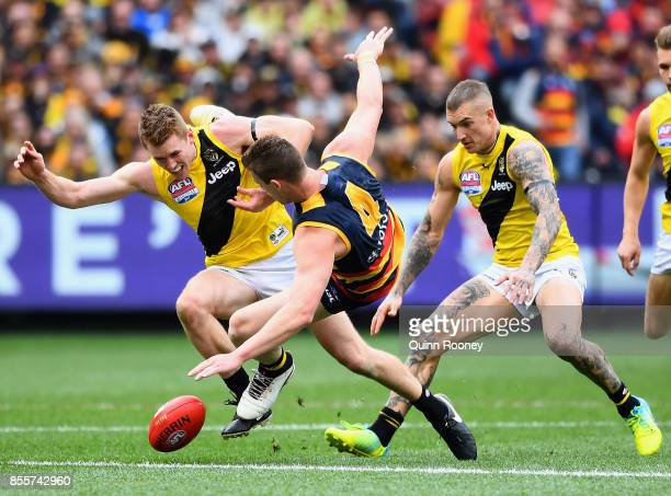 Jacob Townsend of the Tigers bumps Josh Jenkins of the Crows during the 2017 AFL Grand Final match between the Adelaide Crows and the Richmond Tigers...