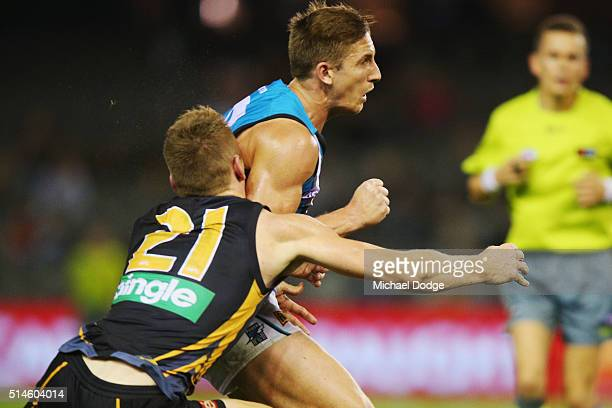 Jacob Townsend of the Tigers collides with Hamish Hartlett of the Power and later gets carried off with a neckbrace during the 2016 AFL NAB Challenge...
