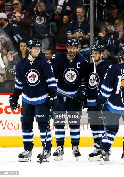 Jacob Trouba and Blake Wheeler of the Winnipeg Jets are all smiles after a third period goal against the Colorado Avalanche at the MTS Centre on...
