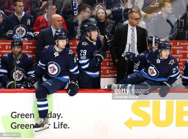 Jacob Trouba and Nikolaj Ehlers of the Winnipeg Jets get set to change on the fly during second period action against the Vegas Golden Knights at the...