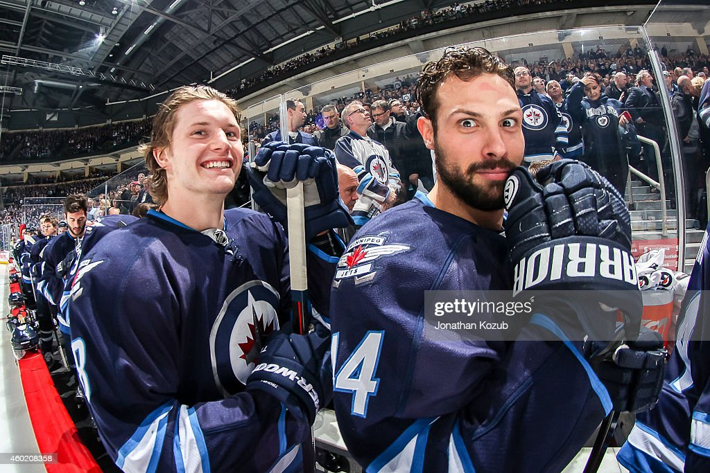 <a gi-track='captionPersonalityLinkClicked' href=/galleries/search?phrase=Jacob+Trouba&family=editorial&specificpeople=8050718 ng-click='$event.stopPropagation()'>Jacob Trouba</a> #8 and <a gi-track='captionPersonalityLinkClicked' href=/galleries/search?phrase=Zach+Bogosian&family=editorial&specificpeople=4195061 ng-click='$event.stopPropagation()'>Zach Bogosian</a> #44 of the Winnipeg Jets are all smiles on the bench prior to puck drop against the Edmonton Oilers on December 3, 2014 at the MTS Centre in Winnipeg, Manitoba, Canada.