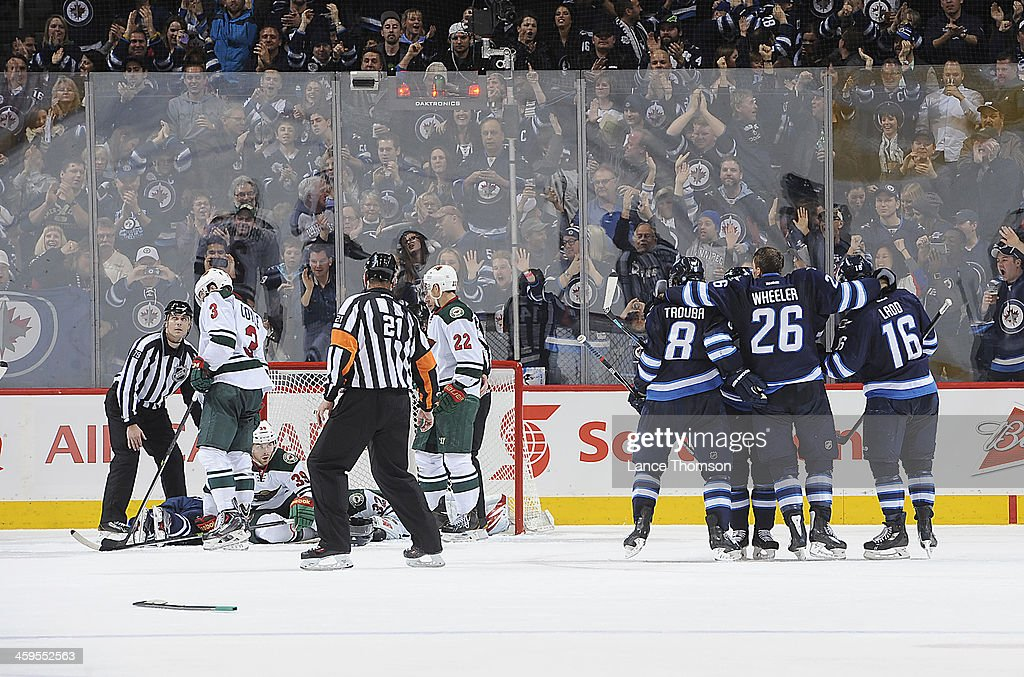 <a gi-track='captionPersonalityLinkClicked' href=/galleries/search?phrase=Jacob+Trouba&family=editorial&specificpeople=8050718 ng-click='$event.stopPropagation()'>Jacob Trouba</a> #8, <a gi-track='captionPersonalityLinkClicked' href=/galleries/search?phrase=Blake+Wheeler&family=editorial&specificpeople=716703 ng-click='$event.stopPropagation()'>Blake Wheeler</a> #26 and <a gi-track='captionPersonalityLinkClicked' href=/galleries/search?phrase=Andrew+Ladd&family=editorial&specificpeople=228452 ng-click='$event.stopPropagation()'>Andrew Ladd</a> #16 of the Winnipeg Jets celebrate a third period goal against the Minnesota Wild at the MTS Centre on December 27, 2013 in Winnipeg, Manitoba, Canada.
