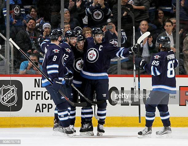 Jacob Trouba Drew Stafford Bryan Little Andrew Ladd and Mathieu Perreault of the Winnipeg Jets celebrate a first period goal against the Dallas Stars...