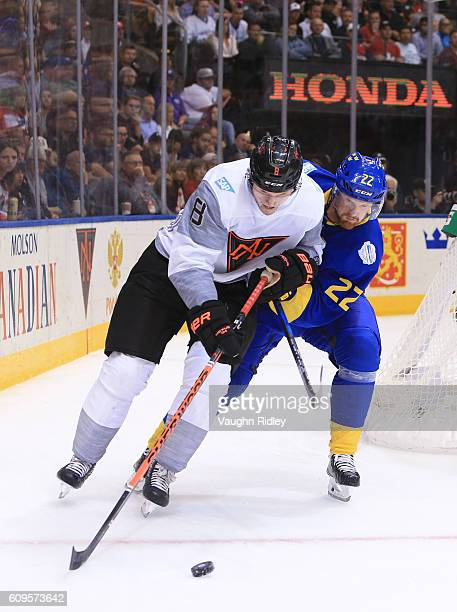 Jacob Trouba of Team North America battles for the puck with Daniel Sedin of Team Sweden during the World Cup of Hockey 2016 at Air Canada Centre on...