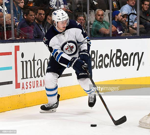 Jacob Trouba of the Winnipeg Jets controls the puck against the Toronto Maple Leafs during game action on November 4 2015 at Air Canada Centre in...