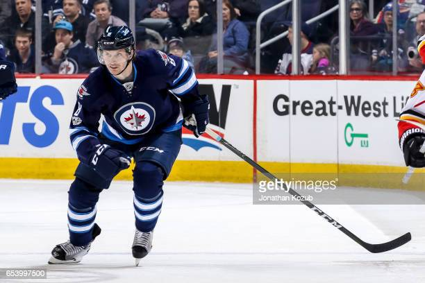Jacob Trouba of the Winnipeg Jets follows the play down the ice during third period action against the Calgary Flames at the MTS Centre on March 11...