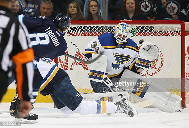 Jacob Trouba of the Winnipeg Jets gets a shot on goaltender Jake Allen of the St Louis Blues during first period action at the MTS Centre on December...