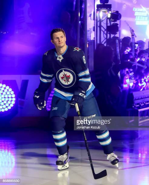 Jacob Trouba of the Winnipeg Jets hits the ice during the player introductions prior to puck drop against the Toronto Maple Leafs in the home opener...