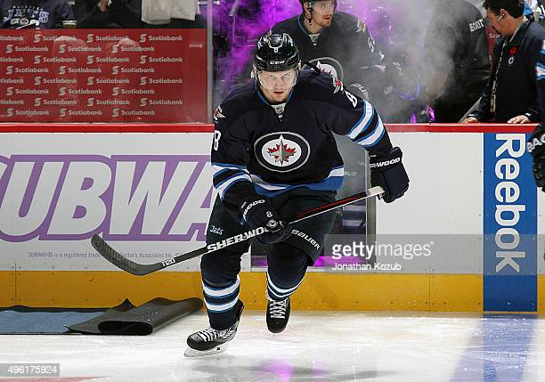 Jacob Trouba of the Winnipeg Jets hits the ice prior to puck drop against the Philadelphia Flyers at the MTS Centre on November 7 2015 in Winnipeg...