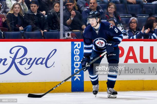 Jacob Trouba of the Winnipeg Jets keeps an eye on the play during a second period faceoff against the Nashville Predators at the MTS Centre on April...