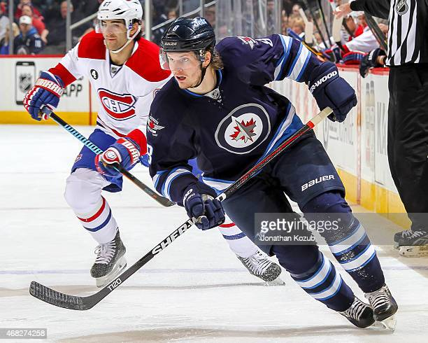 Jacob Trouba of the Winnipeg Jets keeps an eye on the play during first period action against the Montreal Canadiens on March 26 2015 at the MTS...