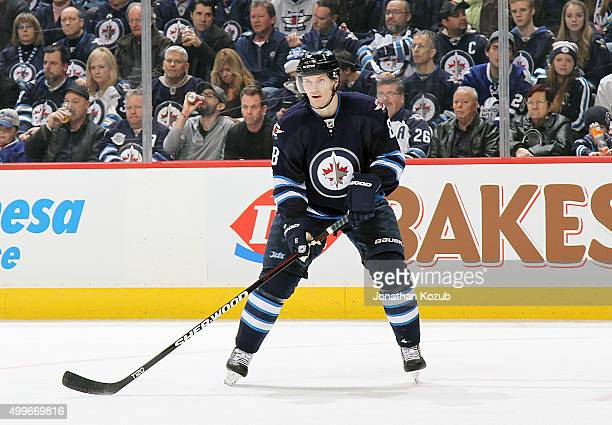 Jacob Trouba of the Winnipeg Jets keeps an eye on the play during second period action against the Toronto Maple Leafs at the MTS Centre on December...