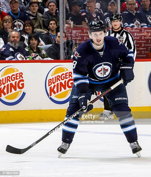 Jacob Trouba of the Winnipeg Jets keeps an eye on the play during second period action against the Chicago Blackhawks at the MTS Centre on April 1...