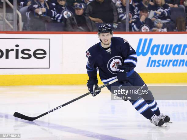 Jacob Trouba of the Winnipeg Jets keeps an eye on the play during second period action against the Vancouver Canucks at the MTS Centre on March 26...