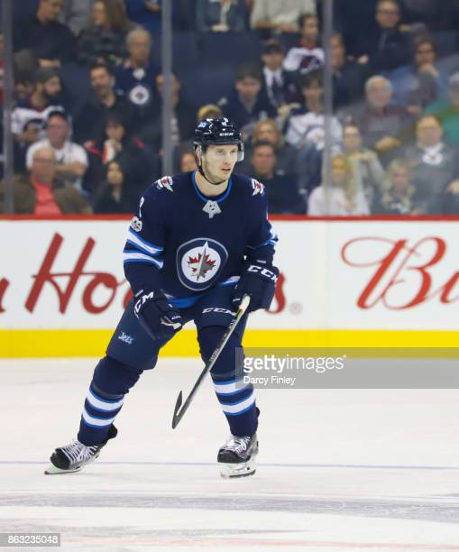 Jacob Trouba of the Winnipeg Jets keeps an eye on the play during first period action against the Carolina Hurricanes at the Bell MTS Place on...