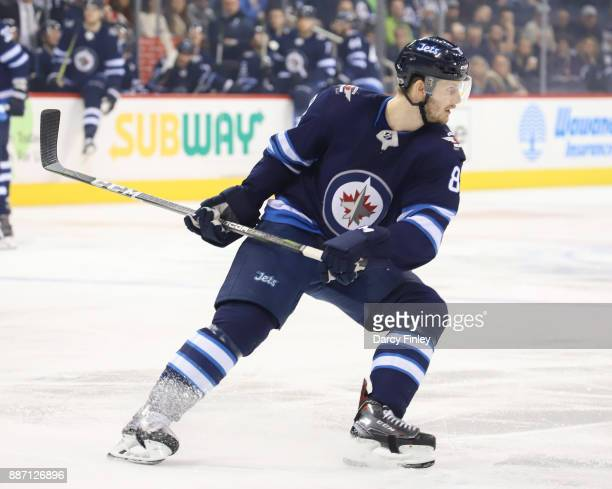 Jacob Trouba of the Winnipeg Jets keeps an eye on the play during first period action against the Vegas Golden Knights at the Bell MTS Place on...