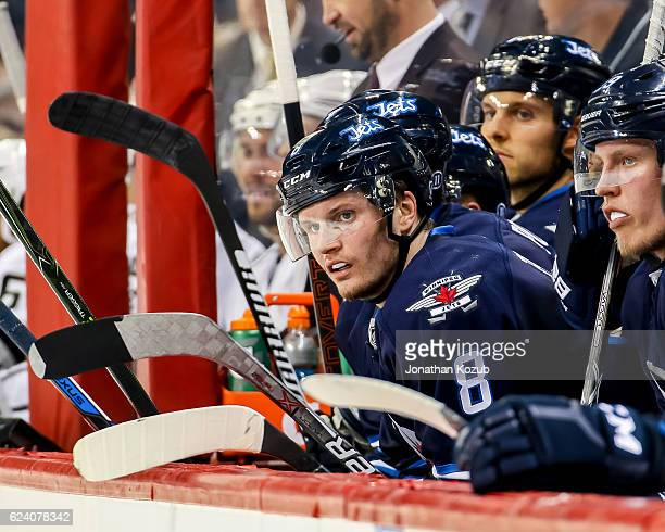 Jacob Trouba of the Winnipeg Jets looks on from the bench during second period action against the Los Angeles Kings at the MTS Centre on November 13...