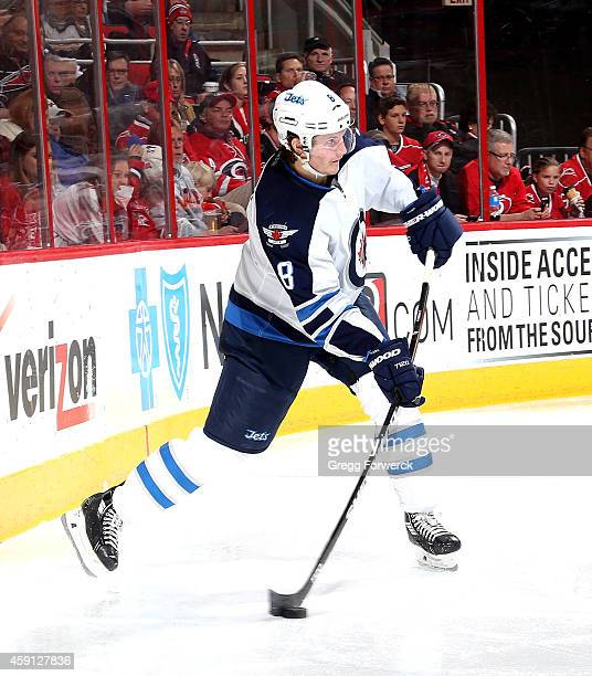 Jacob Trouba of the Winnipeg Jets looks to pass the puck during their NHL game against the Carolina Hurricanes at PNC Arena on November 13 2014 in...