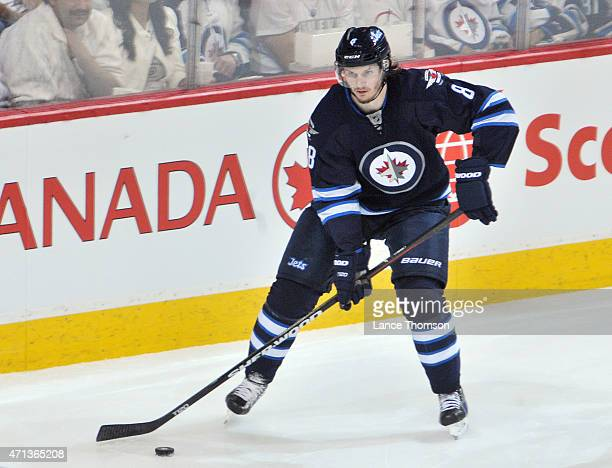 Jacob Trouba of the Winnipeg Jets plays the puck during second period action against the Anaheim Ducks in Game Four of the Western Conference...