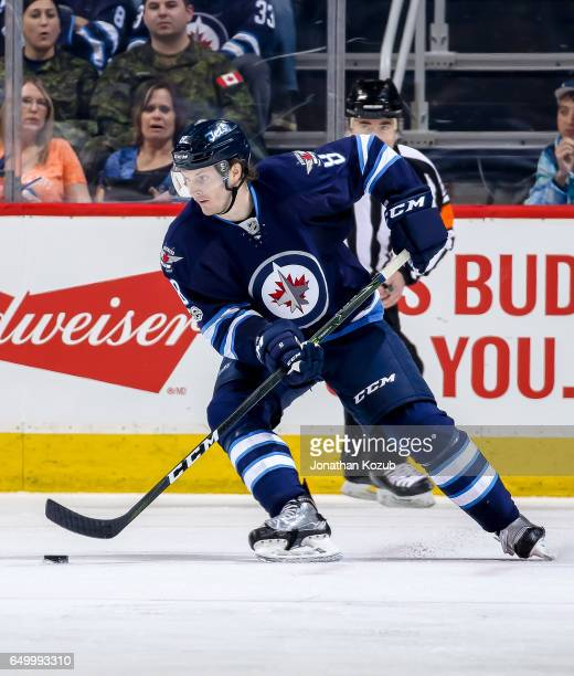 Jacob Trouba of the Winnipeg Jets plays the puck during second period action against the San Jose Sharks at the MTS Centre on March 6 2017 in...