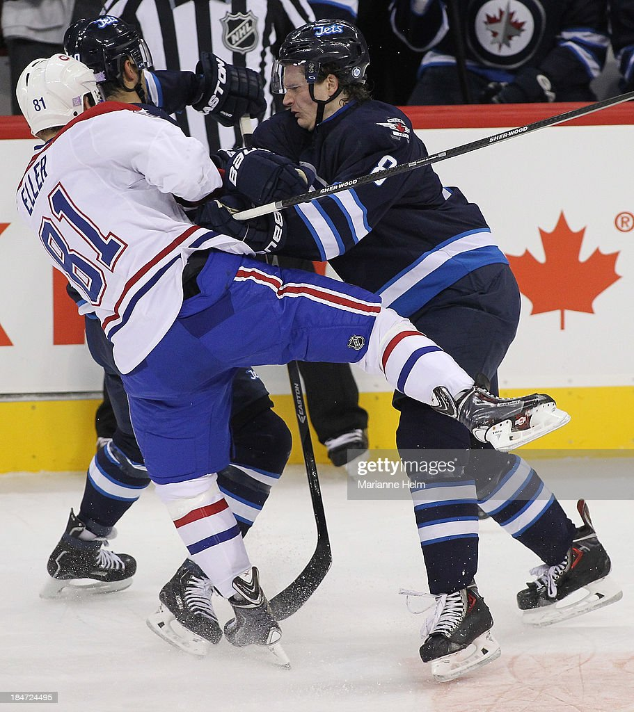 <a gi-track='captionPersonalityLinkClicked' href=/galleries/search?phrase=Jacob+Trouba&family=editorial&specificpeople=8050718 ng-click='$event.stopPropagation()'>Jacob Trouba</a> #8 of the Winnipeg Jets shoves <a gi-track='captionPersonalityLinkClicked' href=/galleries/search?phrase=Lars+Eller&family=editorial&specificpeople=4324947 ng-click='$event.stopPropagation()'>Lars Eller</a> #81 of the Montreal Canadiens in first period action of an NHL game at the MTS Centre on October 15, 2013 in Winnipeg, Manitoba, Canada.