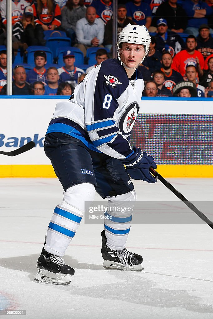 <a gi-track='captionPersonalityLinkClicked' href=/galleries/search?phrase=Jacob+Trouba&family=editorial&specificpeople=8050718 ng-click='$event.stopPropagation()'>Jacob Trouba</a> #8 of the Winnipeg Jets skates against the New York Islanders at Nassau Veterans Memorial Coliseum on October 28, 2014 in Uniondale, New York. The Winnipeg Jets defeated the New York Islanders 4-3.