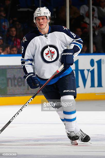 Jacob Trouba of the Winnipeg Jets skates against the New York Islanders at Nassau Veterans Memorial Coliseum on October 28 2014 in Uniondale New York...