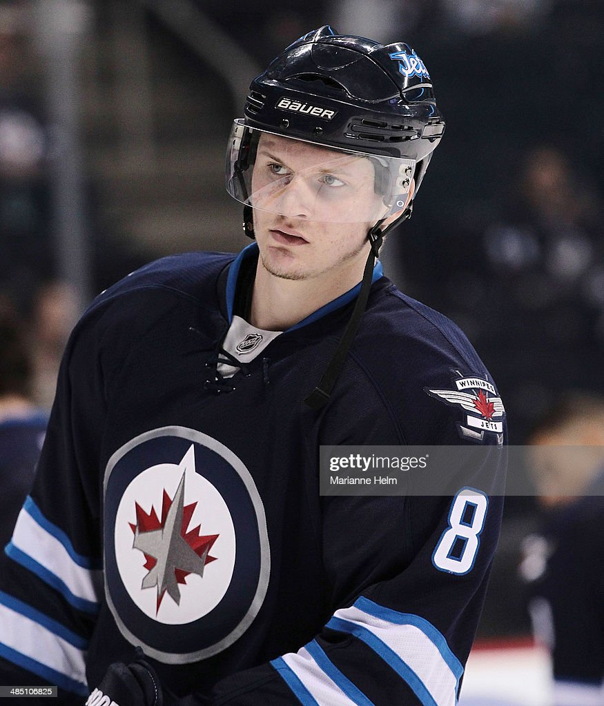 Jacob Trouba #8 of the Winnipeg Jets skates down the ice during warmup before an NHL game against the Boston Bruins at the MTS Centre on April 10, 2014 in Winnipeg, Manitoba, Canada.