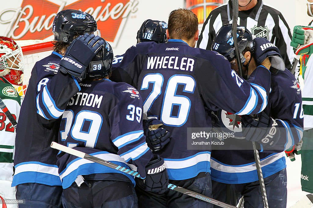 <a gi-track='captionPersonalityLinkClicked' href=/galleries/search?phrase=Jacob+Trouba&family=editorial&specificpeople=8050718 ng-click='$event.stopPropagation()'>Jacob Trouba</a> #8, <a gi-track='captionPersonalityLinkClicked' href=/galleries/search?phrase=Tobias+Enstrom&family=editorial&specificpeople=2538468 ng-click='$event.stopPropagation()'>Tobias Enstrom</a> #39, <a gi-track='captionPersonalityLinkClicked' href=/galleries/search?phrase=Bryan+Little&family=editorial&specificpeople=540533 ng-click='$event.stopPropagation()'>Bryan Little</a> #18, <a gi-track='captionPersonalityLinkClicked' href=/galleries/search?phrase=Blake+Wheeler&family=editorial&specificpeople=716703 ng-click='$event.stopPropagation()'>Blake Wheeler</a> #26 and <a gi-track='captionPersonalityLinkClicked' href=/galleries/search?phrase=Andrew+Ladd&family=editorial&specificpeople=228452 ng-click='$event.stopPropagation()'>Andrew Ladd</a> #16 of the Winnipeg Jets celebrate a third period goal against the Minnesota Wild at the MTS Centre on December 27, 2013 in Winnipeg, Manitoba, Canada.