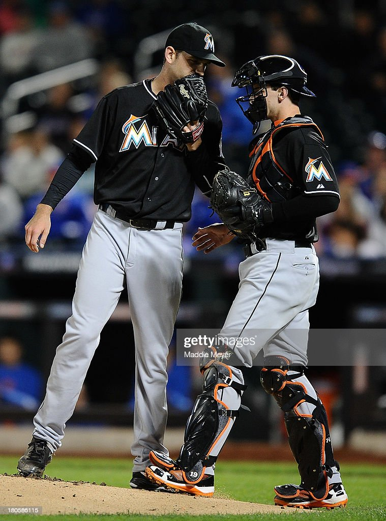 Jacob Turner #33 of the Miami Marlins talks with teammate Rob Brantly #19 during the first inning of game two of a doubleheader against the New York Mets on September 14, 2013 at Citi Field in the Flushing neighborhood of the Queens borough of New York City.