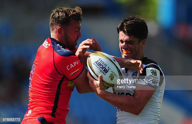 Jacob Unwin of Bath Rugby is tackled by Sam Jeffries of Bristol Rugby during the Singha Premiership Rugby 7s Series match between Bristol Rugby and...