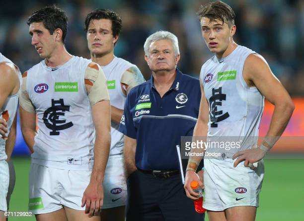 Jacob Weitering Jack Silvagni and Patrick Cripps of the Blues look dejected after defeat with Neil Craig during the round five AFL match between the...