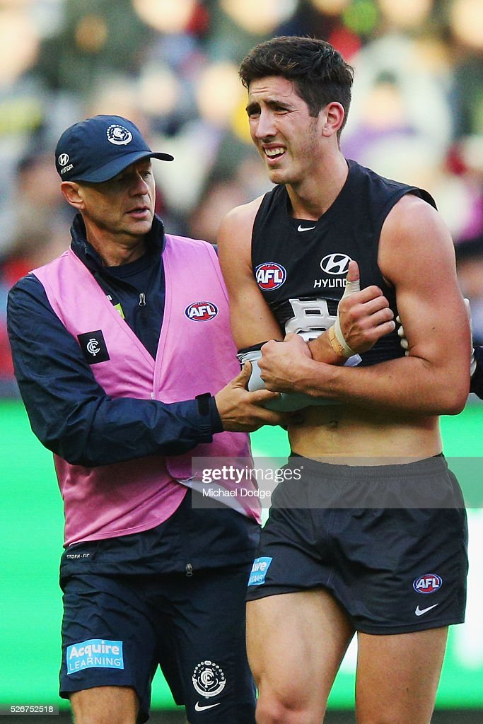 Jacob Weitering of the Blues comes off injured during the round six AFL match between the Carlton Blues and the Essendon Bombers at Melbourne Cricket Ground on May 1, 2016 in Melbourne, Australia.