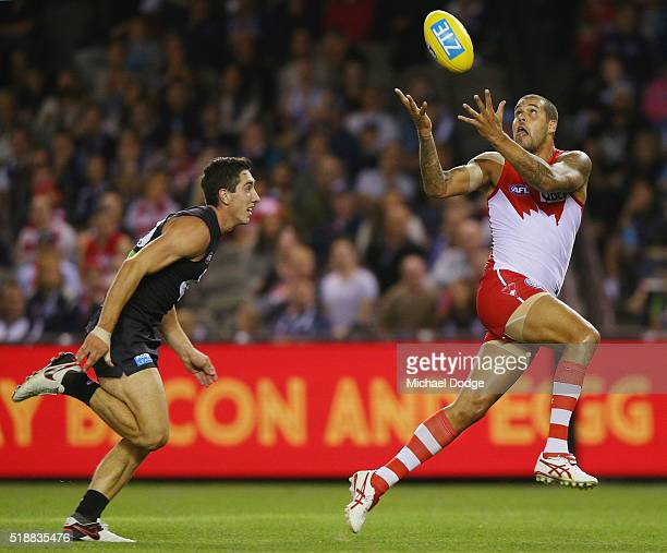 Jacob Weitering of the Blues is caught behind Lance Franklin of the Swans during the round two match between the Carlton Blues and Sydney Swans at...