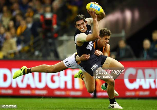 Jacob Weitering of the Blues is tackled during the round 22 AFL match between the Carlton Blues and the Hawthorn Hawks at Etihad Stadium on August 19...
