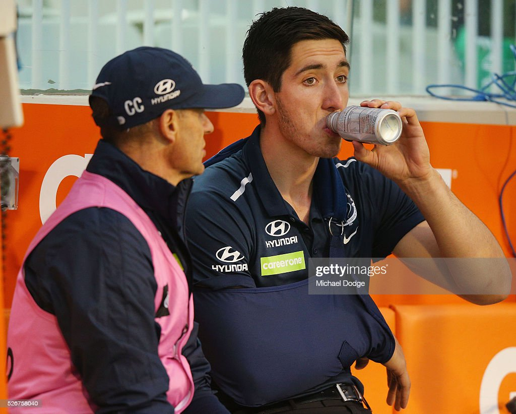 Jacob Weitering of the Blues wears a sling after being injured during the round six AFL match between the Carlton Blues and the Essendon Bombers at Melbourne Cricket Ground on May 1, 2016 in Melbourne, Australia.