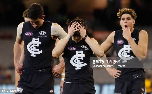 Jacob Weitering Zac Fisher and Charlie Curnow of the Blues look dejected after a loss during the 2017 AFL round 16 match between the Carlton Blues...