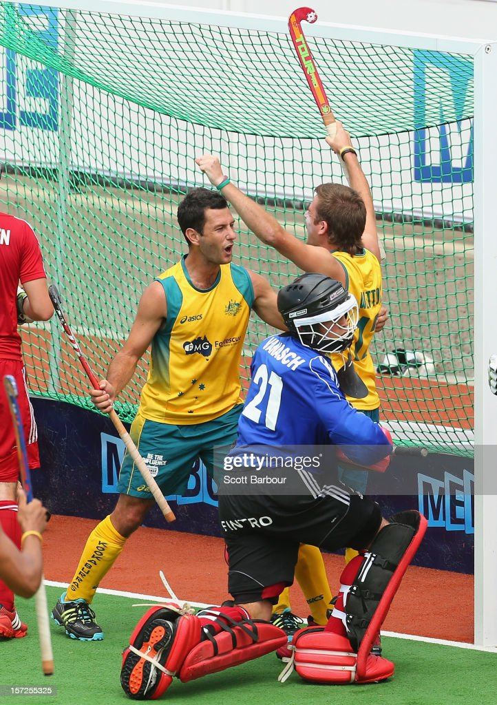Jacob Whetton of Australia celebrates with Jamie Dwyer after scoring a goal during the match between Australia and Belgium on day one of the Champions Trophy on December 1, 2012 in Melbourne, Australia.