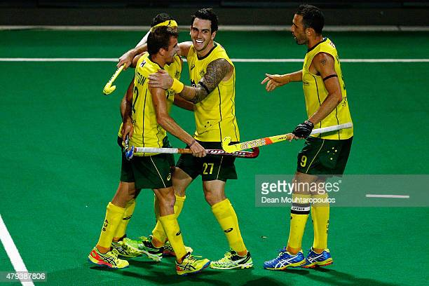 Jacob Whetton of Australia celebrates with team mates after he scores a goal during the Fintro Hockey World League SemiFinal match between Australia...
