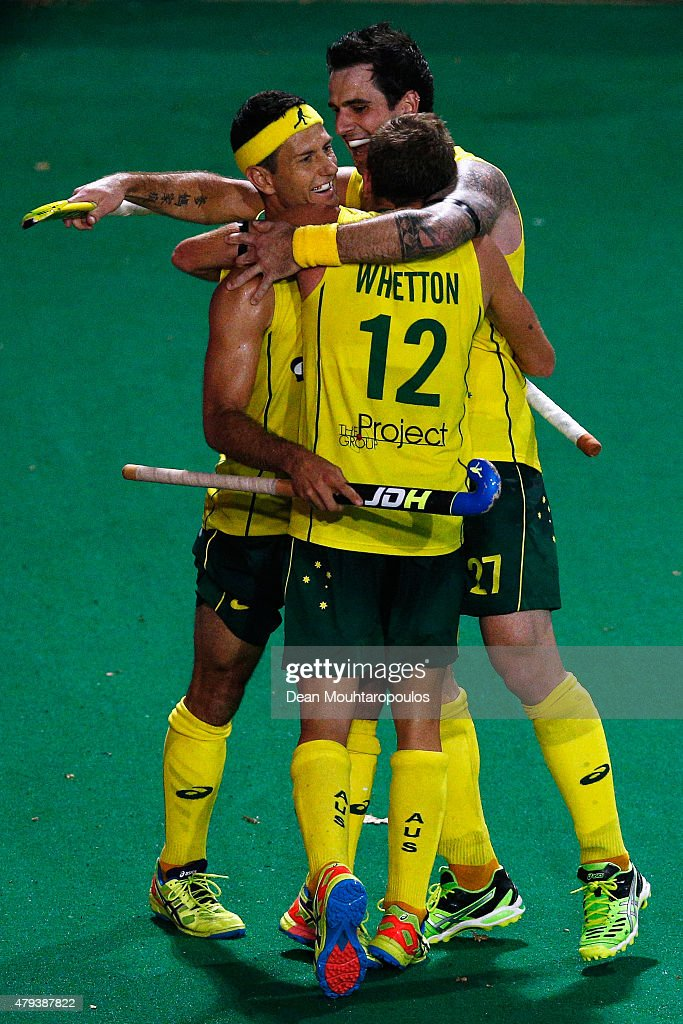 Jacob Whetton #12 of Australia celebrates with team mates after he scores a goal during the Fintro Hockey World League Semi-Final match between Australia and Great Britain held at KHC Dragons Gemeentepark Stadium on July 3, 2015 in Brasschaat, Belgium.