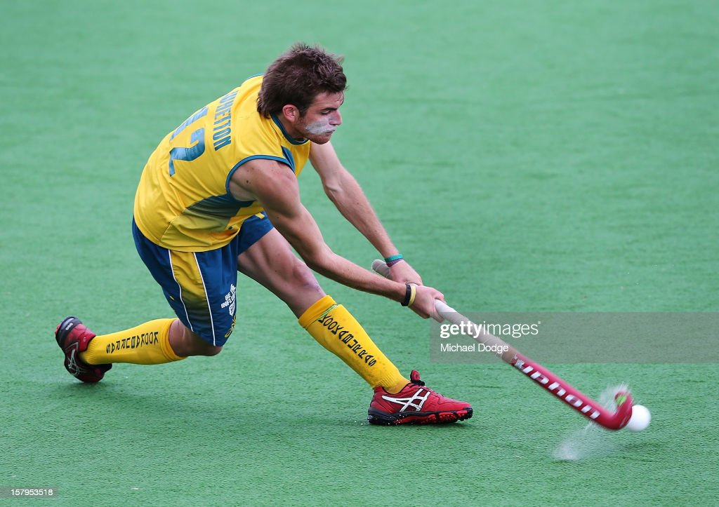 Jacob Whetton of Australia hits the ball during the match between Australia and India during day five of the 2012 Champions Trophy at the State Netball and Hockey Centre on December 8, 2012 in Melbourne, Australia.
