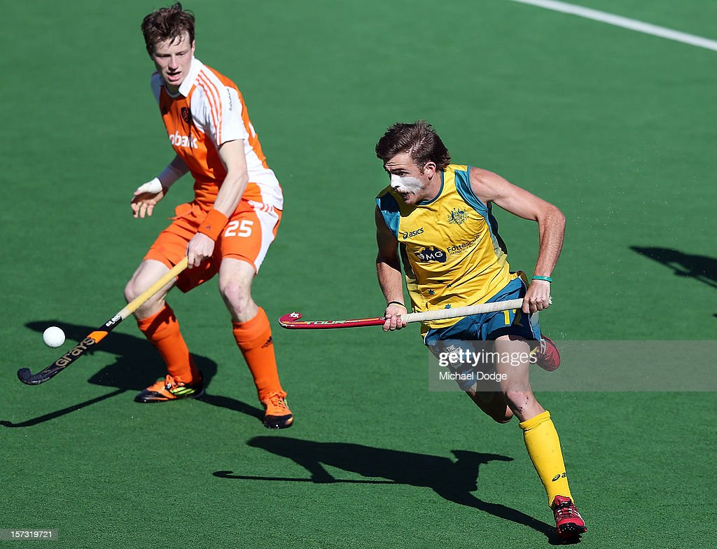 Jacob Whetton of Australia runs with the ball against Severiano van ASS of the Netherlands in the last five seconds of the match between Australia and the Netherlands during day two of the Champions Trophy on December 2, 2012 in Melbourne, Australia. Ê